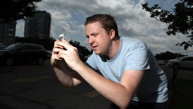 """CJ summer intern Bobby Shipman playing """"Pokemon Go"""" on Wednesday in downtown Louisville. He says the new interest in Pokemon isn't new for everyone as some enthusiasts have never stopped playing."""