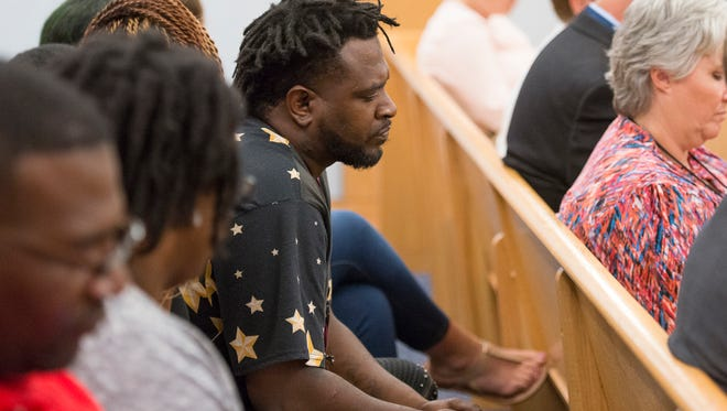 Jonathan Cook, father of slain Jaibreon Cook, listens during Jordan Dumas' sentencing at the Escambia County courthouse in Pensacola on Wednesday, June 13, 2018.  Dumas was found guilty for negligent homicide in the shooting death of 16-year-old Jaibreon Cook.
