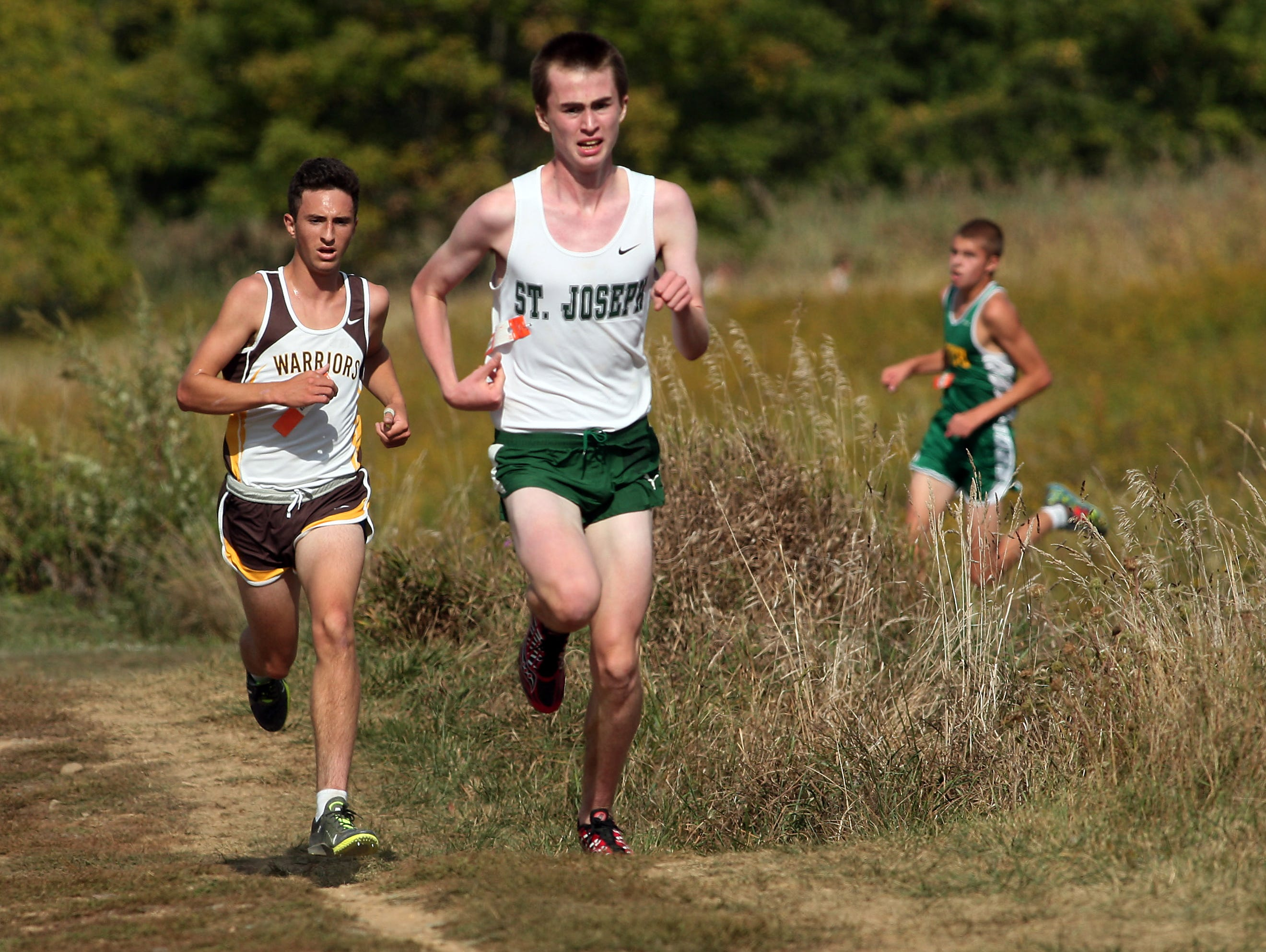 St Joseph's Dylan Tyrell leads Watchung's Ryan Martins during the Varsity boys A 5K run of the Stewart Memorial Invitational at Central Park of Morris County. September 26, 2015, Morris Plains, NJ.