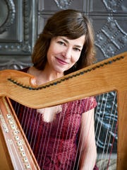 Celtic harpist Kim Robertson returns to her home state