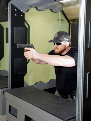 Blackhawk Shooting Sports range manager Shane Anderson, of Cedar Grove, demonstrates typical use of the target range March 24, 2017, in Oostburg.