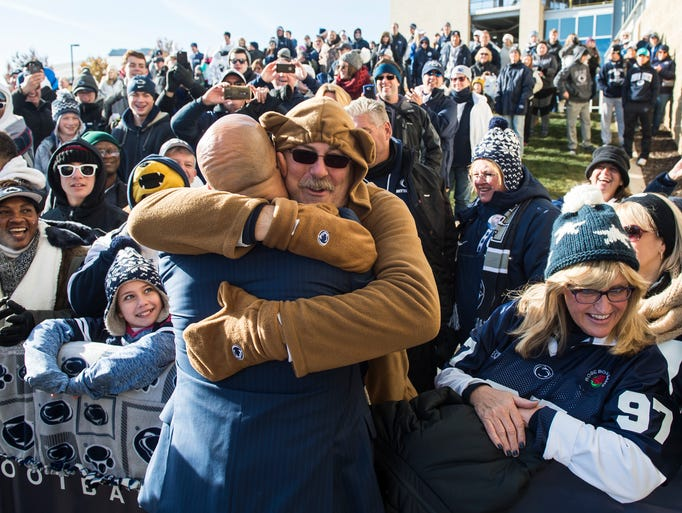 Larry Buchholz, dressed as the Nittany Lion mascot,