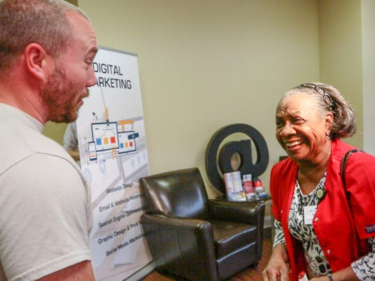 John Gurley, left, meets Doris Baskin, right, both of Anderson, for the first time. Gurley, who looks for silver and gold with his metal detector, found her lost 1964 Westside High School class ring. Baskins said she lost the ring 52 years ago on the grounds of the former Anderson Country Club.
