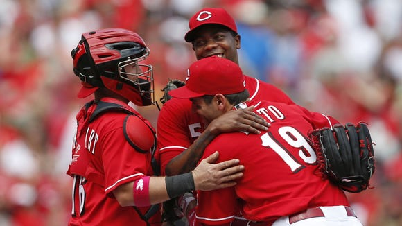 Cincinnati Reds Joey Votto gives a big post-game hug to relief pitcher Aroldis Chapman (54). He pitched in the ninth inning, earning the save against the Colorado Rockies at Great American Ball Park.