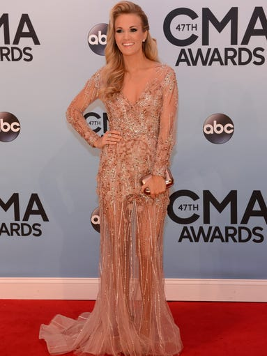 At Wednesday night's CMA Awards in Nashville, country stars went glam. But it was Carrie Underwood who caught our eye -- not just because of her looks, but because of just how MANY of them the event's co-host showed off in one night. Here, she hits the red carpet in Ralph & Russo.