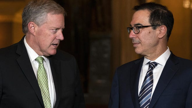 Treasury Secretary Steven Mnuchin and White House chief of staff Mark Meadows look to each other as they speak to media on Capitol Hill in Washington, Thursday, Aug. 6, 2020.