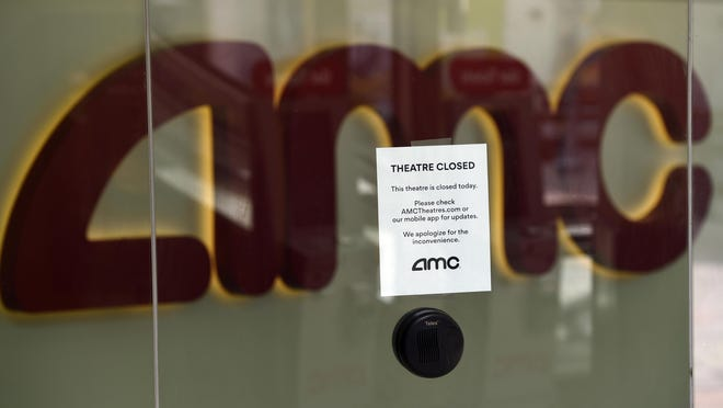 FILE - In this April 29, 2020 file photo, a message on the ticket window at the AMC Burbank 16 movie theaters complex informs potential customers that it is currently closed in Burbank, Calif.  AMC says its business is suffering because of the coronavirus pandemic and it may not survive. All of the company's theaters are shut down through June, and while the theaters are closed the company is generating no revenue.