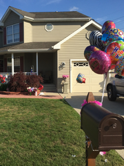 Happy Birthday balloons flutter outside Carol Bowne's house on Saturday, the same day her accused killer Michael Eitel was found dead from suicide.