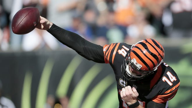 Bengals quarterback Andy Dalton spikes the ball after breaking through for a QB sneak touchdown.