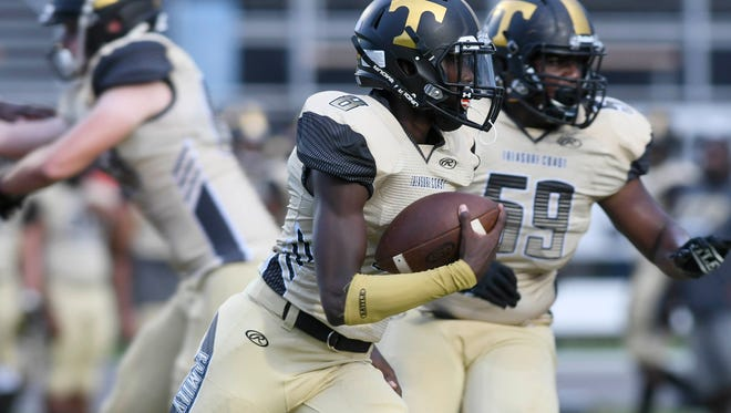 Tyrec Thompson of Treasure Coast runs the ball during Friday's game against Cocoa.