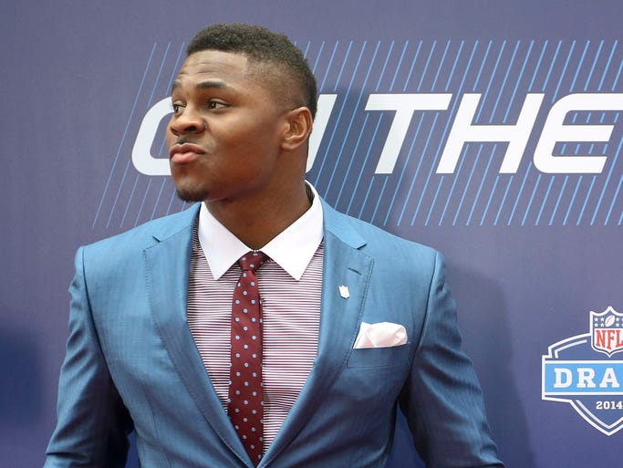 Buffalo linebacker Khalil Mack poses for photos on the red carpet upon arriving for the first round of the 2014 NFL Draft, Thursday, May 8, 2014, in New York.