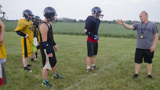 CPS Coach Joe Rickett explains a drill Monday, Aug. 15, 2016 during a practice at CPS High School.