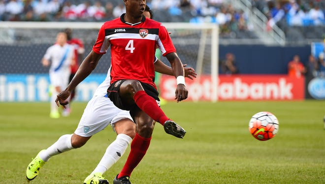Trinidad & Tobago defender Sheldon Bateau kicks the ball against Guatemala in the first half during CONCACAF Gold Cup group play at Soldier Field.