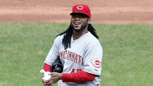 Reds starting pitcher Johnny Cueto reacts to being jeered by Pittsburgh Pirates fans during the sixth inning at PNC Park. The Reds won 3-2.