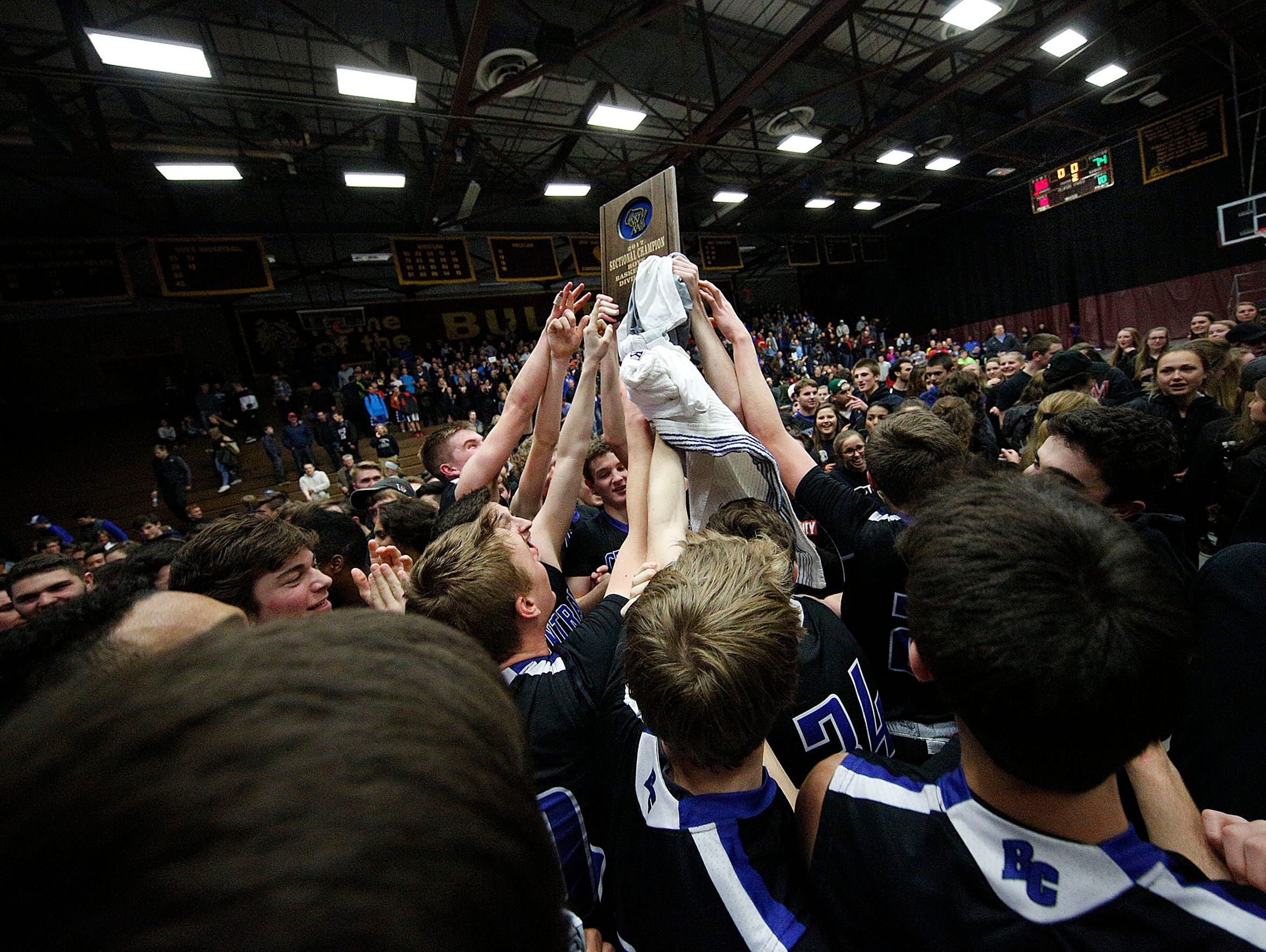 Brookfield Central Players react on the court with