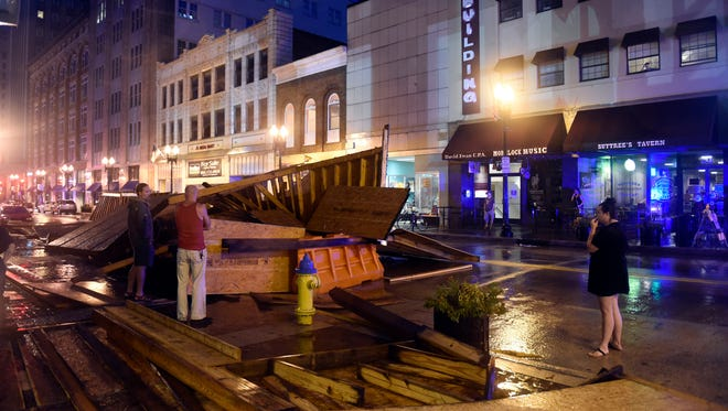 A covered walkway collapsed in Knoxville, Tenn., after a July 27 storm.
