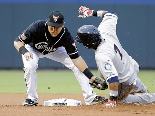 RUBEN R RAMIREZ—EL PASO TIMES Chihuahuas second baseman Taylor Lindsey puts the tag on Tacoma Rainiers second baseman Ketel Marte duting action intheir game three in the openig series of the 2015 season.