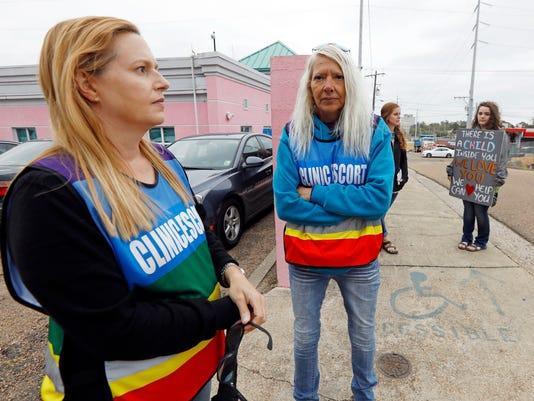 032018 abortion clinic escorts vs. protesters
