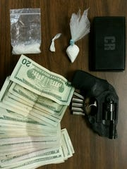 Drugs, a gun and cash found during a traffic stop Tuesday
