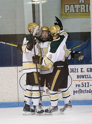 Howell hockey players celebrate a goal in a 4-0 victory over Milford.