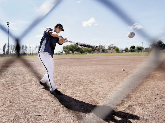 Faith Christian's Rafael Rucobo hits balls during practice Wednesday at Capistrano Park. The Lions made the Texas Christian Athletic League state playoffs this year in just their third varsity season.