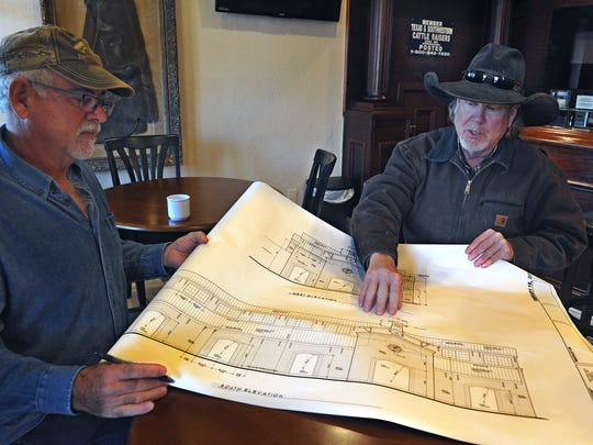 Nocona City Councilor Bob Ferguson, left, and contractor Dan Fenoglio talk about plans for a farmers market and community events center that includes new construction and renovation of the old Justin Boot Company building at the south entrance to downtown. The boot-making and leather goods history of Nocona dates back to 1879 with H.J. Justin making boots for cowboys on the Chisholm Trail.