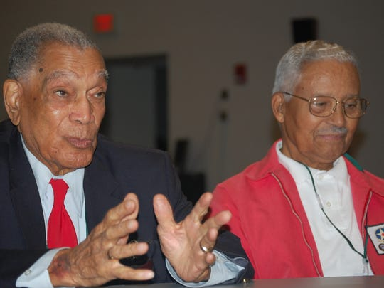 Former Tuskegee Airmen Lee Archer, left, and Charles McGee recall their experiences during World War II during a panel discussion in 2008.