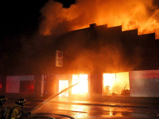 The Burkburnett Volunteer Fire Department and additional units from Friberg Cooper VFD, Wichita Falls Fire Department and Sheppard Air Force Base Fire Department battle a late-night fire at the Elliott's Auto building on East Second Street in Burkburnett.