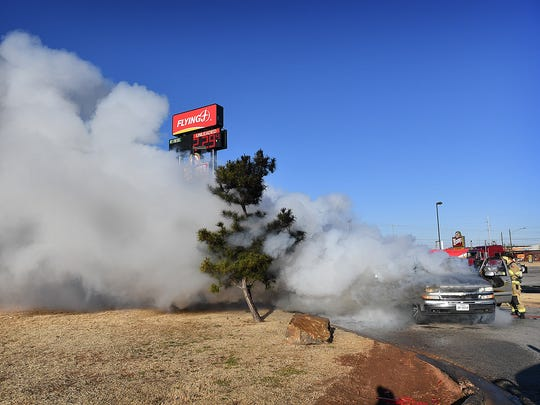 Smoke billows from a SUV on fire at the Flying J Truckstop