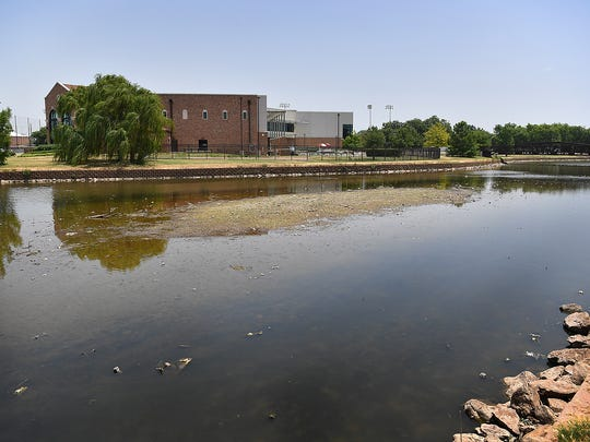 The water level of Sikes Lake on the museum side has dropped significantly in the last few weeks with the lack of rainfall.