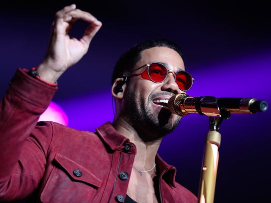 Bachata singer Romeo Santos performs on stage during a concert in Santiago, Chile,, Tuesday.