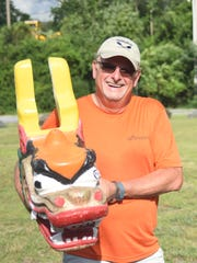 Barry Howard of 22 Dragons carries the dragon head