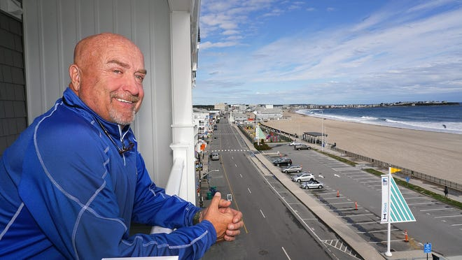 Chuck Bellemore, owner of the new Beach View Oceanfront Residences, at the corner of Ocean Boulevard and I Street at Hampton Beach, looks out over the beach from a fifth-floor apartment.