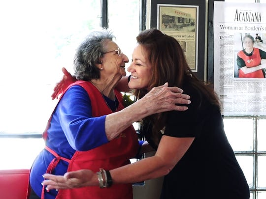 Ella Meaux gets a hug from owner Kackie Lerille at her retirement party after working 56 years at Borden's Ice Cream Shoppe in Lafayette Tuesday.