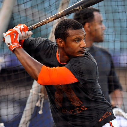 Oct 1, 2014; Baltimore, MD, USA; Baltimore Orioles center fielder Adam Jones (10) takes batting practice during workouts the day before game one of the 2014 ALDS at Oriole Park at Camden. Mandatory Credit: Joy R. Absalon-USA TODAY Sports