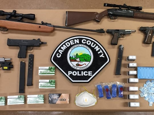 Police say they seized suspected drugs, guns and money