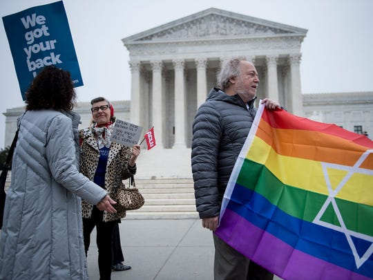 People gather outside the US Supreme Court before Masterpiece Cakeshop vs. Colorado Civil Rights Commission is heard on Dec. 5, 2017 in Washington, DC.