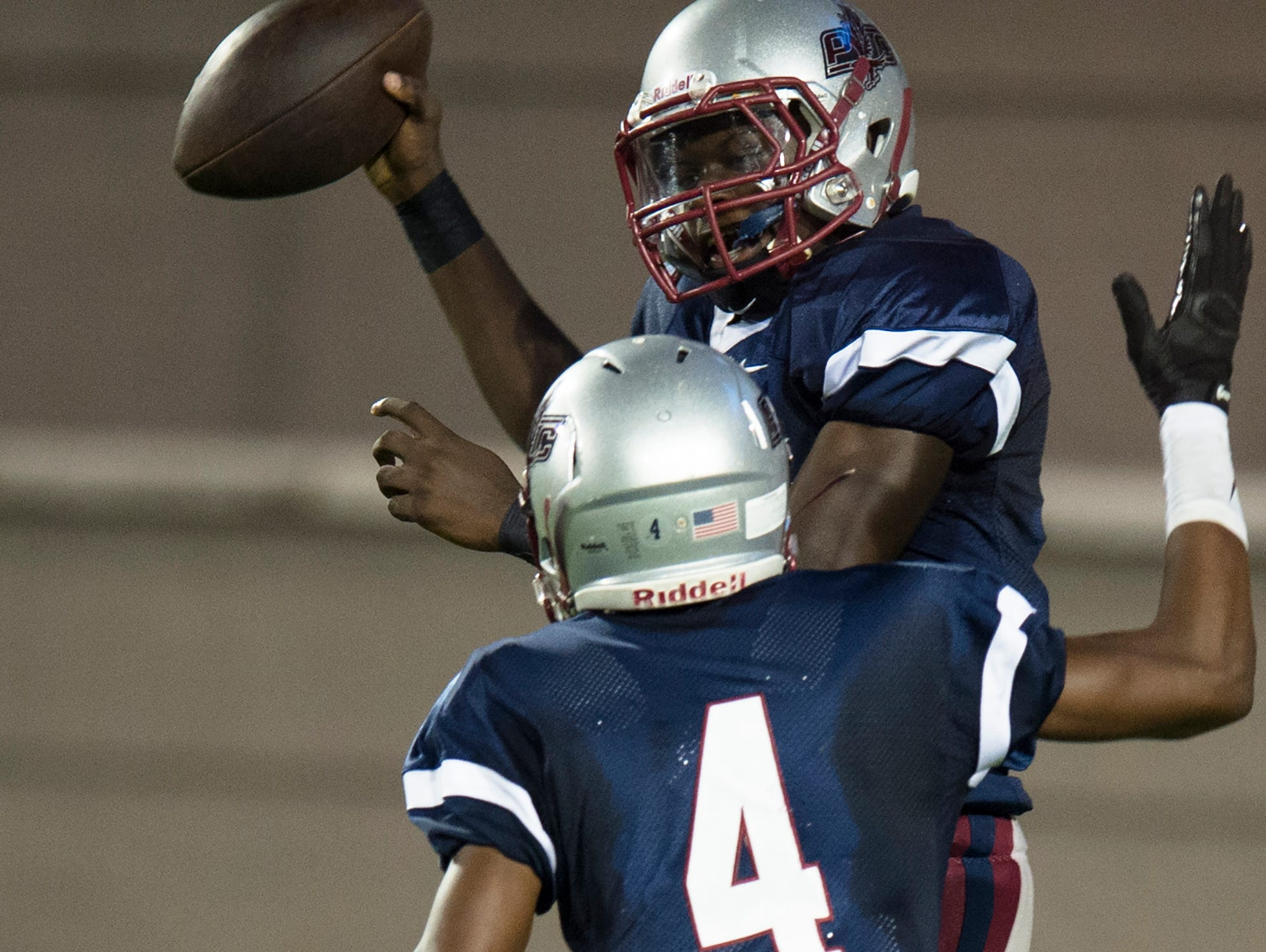 Park Crossing's Malik Cunningham celebrates with Tarrance Scott after scoring a touchdown during the AHSAA football game between Park Crossing High and Dothan High on Thursday, Sept. 3, 2015, in Montgomery, Ala.