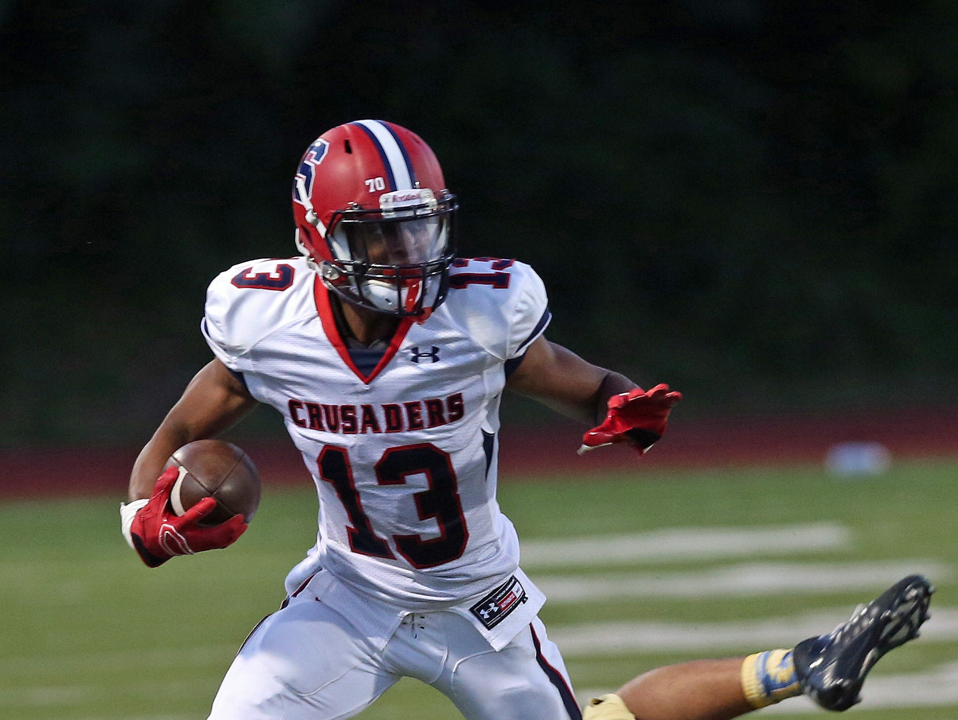Stepinac's DeVante Reid (13) looks for some running room in the Newburgh defense during football game at Newburgh Free Academy Sept. 11, 2015