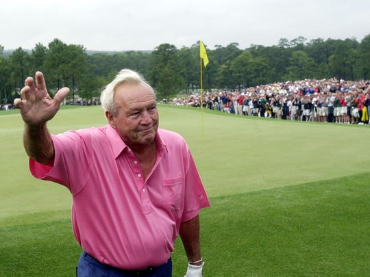 Four-time Masters champion Arnold Palmer waves to the