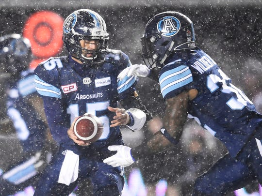 Toronto Argonauts quarterback Ricky Ray (15) of Redding hands the ball off to Toronto Argonauts running back James Wilder Jr. (32) during the first half of a CFL football game in the Grey Cup in Ottawa on Sunday, Nov. 26, 2017.