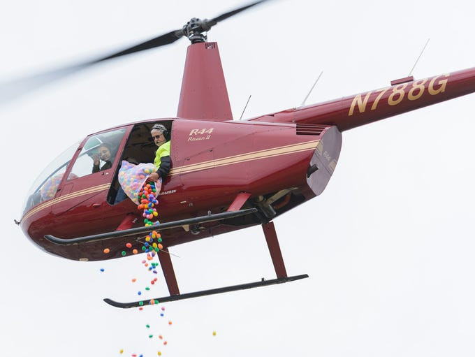 Easter eggs are dropped from a helicopter during the
