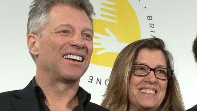 THOMAS P. COSTELLO/STAFF PHOTOGRAPHERJon Bon Jovi, Board Chairman of the JBJ Soul Fondation, is shown with his wife Dorothea Hurley after an event in Toms River, April 14, announcing the construction of the BEAT Center. Bon Jovi and Hurley will host a political fundraiser for Democratic presidential candidate Hillary Clinton on June 29, according to her campaign website.