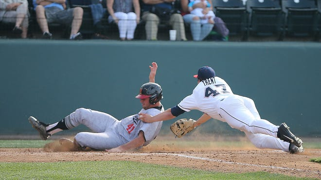 Ole Miss' Christian Trent reaches to tag a sliding Kevin Biondic as he scores for Maryland during an NCAA regional game at Jackie Robinson Stadium in Los Angeles.