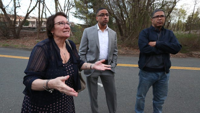 Barbara Greenwald, Dan Johnson and Anthony Herrera are among a group of New Hempstead residents concerned about proposed housing developments April 17, 2017. They were meeting near a development site on Station Rd. in New Hempstead.