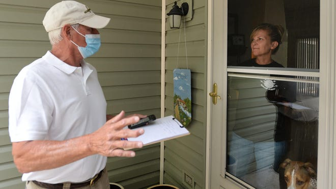 Tom Eddy of Fairview Township, an Erie County Republican committee member, talks with Julie Funkhouser in Millcreek Township on Aug. 26. Eddy was going door-to-door in support of Donald Trump and local Republican candidates.