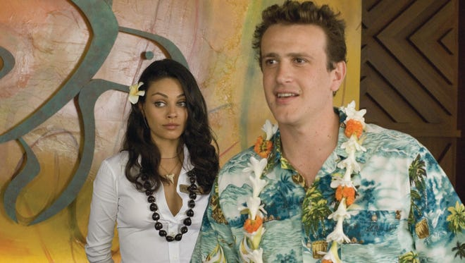 "Sparks fly between Rachel (Mila Kunis) and Peter (Jason Segel) when he escapes to Hawaii after a bad breakup in ""Forgetting Sarah Marshall."""