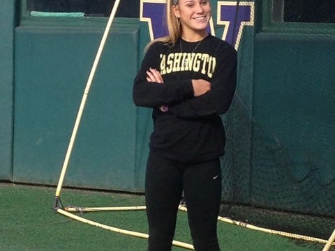 Stormy Kotzelnick poses in her University of Washington gear at the school.