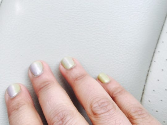 Why is my gel nail polish manicure changing color on one hand?