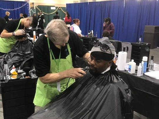 Not only are medical services offered at the event, haircuts and beard trims are also offered.
